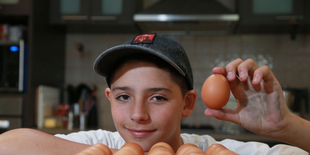 12-year-old Levi Lamb has developed his own business delivering free range eggs to people's doors. Picture: Andrew Ritchie.