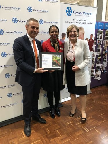 Health Minister Roger Cook presents a Lotterywest cheque to ConnectGroups chair Pearl Proud and patron Prof. Lyn Beazley.