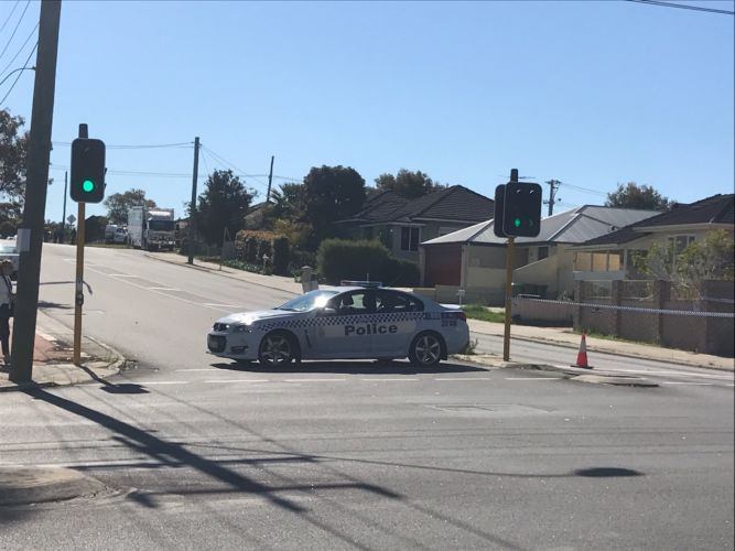 Police have blocked off a section of Coode Street in Bedford. Picture: Kristie Lim.