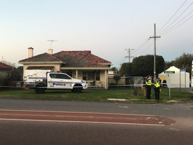 Police on Coode Street near the scene of the Bedford deaths. Picture: Kristie Lim.