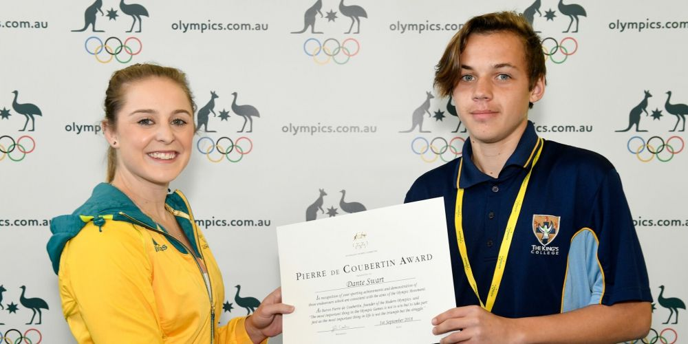 Dante Swart receives his award from Olympian Lauren Mitchell.