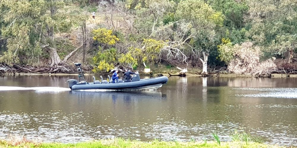 Searchers on the Swan River today. Photo: David Baylis
