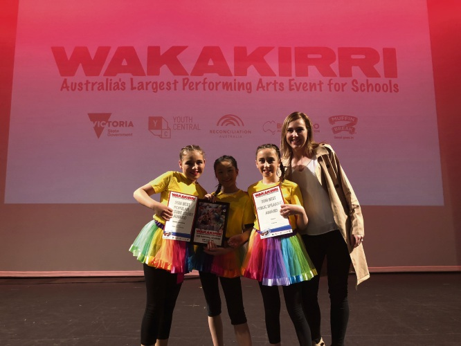 Parkwood Primary School students (L to R) Jessica Toohey, Kaitlin La, Hayley Swaine and performing arts teacher Carly Hart.