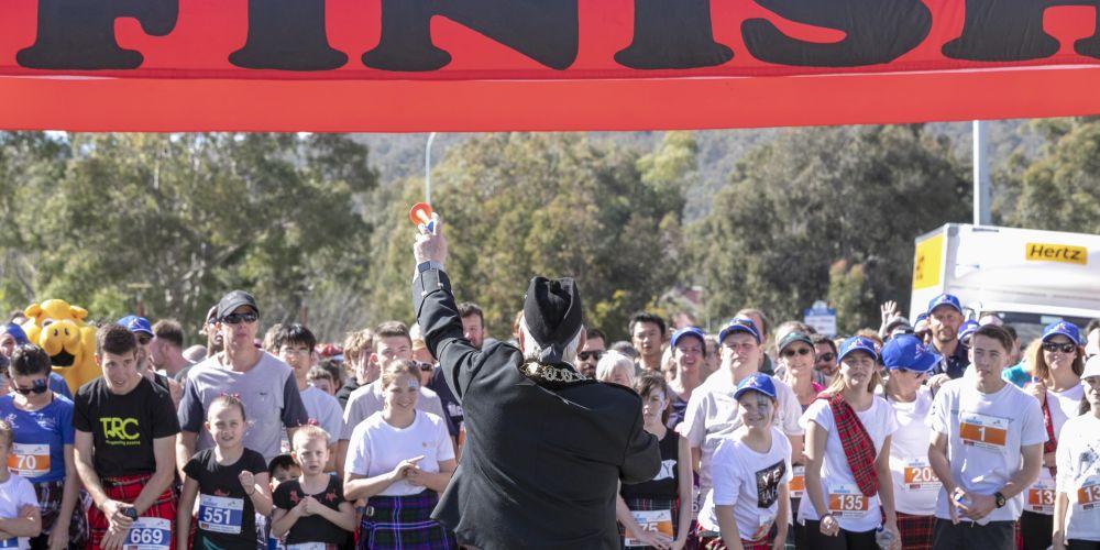 Runners prepare to start the Perth Kilt Run.