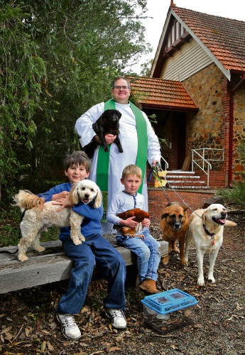 Matthew Saunders (11), of Darlington, and  Alfie, Harry Allan (4), of Helena Valley, with chicken Isla and, at back, Father Chris Bedding next to German shepherd Charley and labrador Elle while holding pug Midnight. Picture: David Baylis d486704