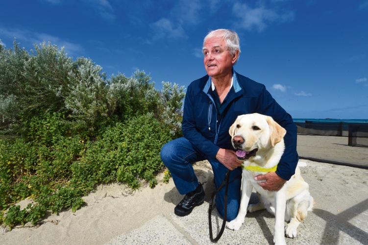 David Goddard with guide dog Olly.