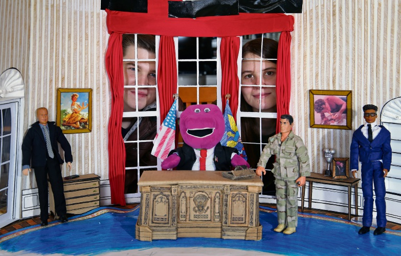 Series creators L-R: Russell and Montana Roberts of West Swan with the Oval office set featuring President Barney, Michaels (Blue suit), Jefferies (Black suit) and General Testosterone. Photo: David Baylis