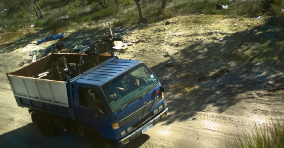 Butera filmed driving a blue Mazda tip truck in   State forest at Jandabup.