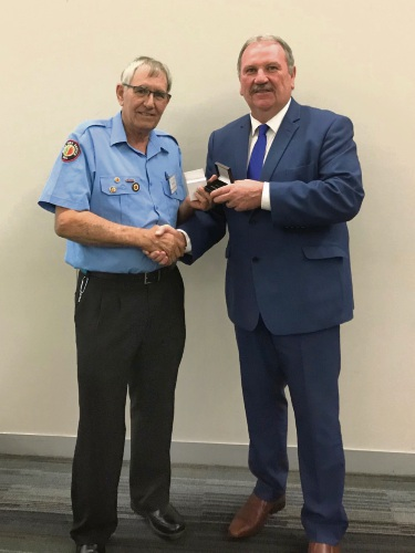 City of Rockingham Mayor Barry Sammels presents the National Medal to Bert Scarrott for 35 years service.