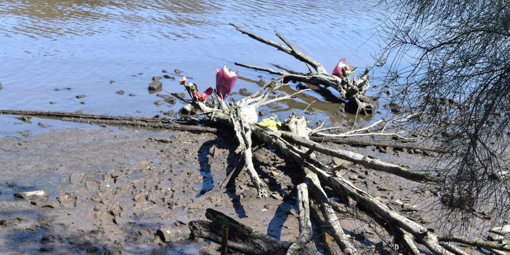 Flowers laid by friends along the Swan River bank in Maylands. Picture: Kristie Lim