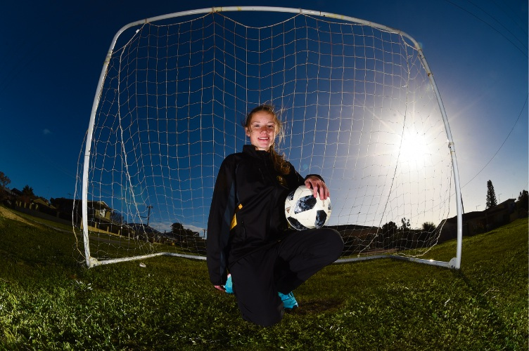Falcon girl competing in soccer championships in Sydney