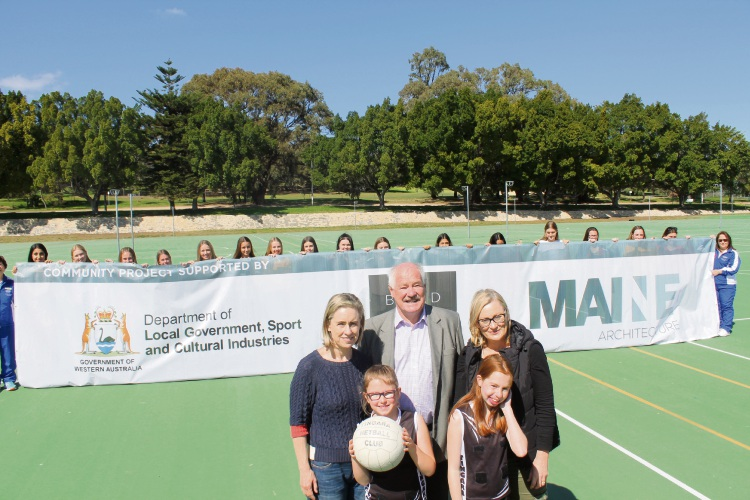 Sport and Recreation Minister Mick Murray, Fremantle MLA Simone McGurk and Bicton MLA Lisa O'Malley with netball players at Frank Gibson Park before construction of the new pavilion began.