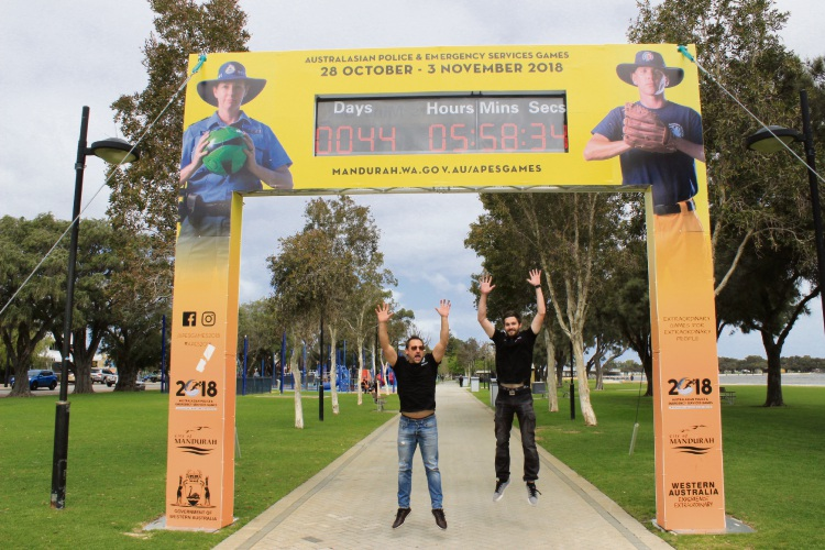 Peter McAppion and Ryan Miller at the countdown clock on the eastern foreshore.