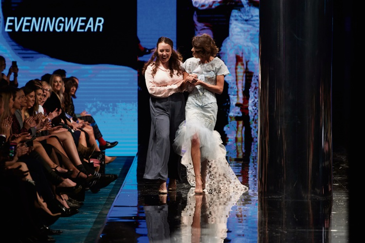 Catherine Kelly (left) reacting to news of her Future Runway win, alongside a model wearing her piece.  Photo: Stefan Gosatti-Telstra Perth Fashion Festival.