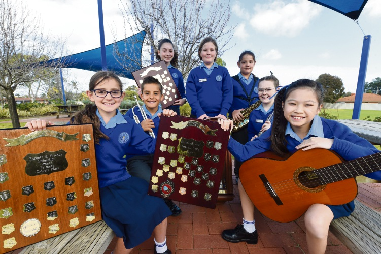 Orana Catholic Primary School students Livvy Leech, left, Rhys Cameron, Isabella Ghobrial, Hayden Osterberg, Levi Munn, Zarissa Keogh and Chloe Chang with their Catholic Schools Performing Arts Festival awards. Picture: Jon Hewson.