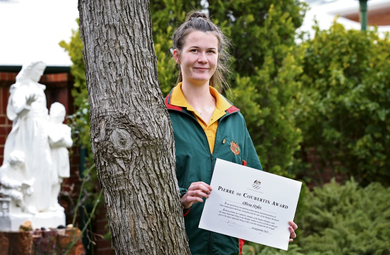La Salle College student Olivia Styles (16) of High Wycombe with her Pierre de Coubertin Award. Picture: David Baylis.