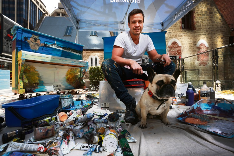Artist Jacob Butler with his dog at Brookfield Place. Picture: Andrew Ritchie