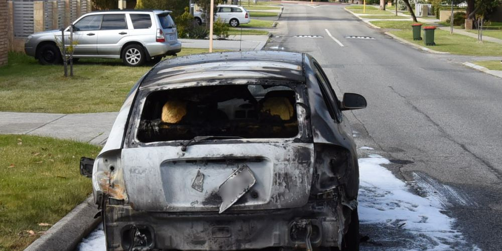 One of the cars torched in the arson spree in Tuart Hill and Osborne Park.