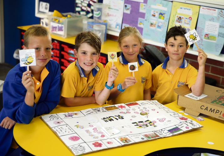 Year 4 students James McIlveen, Jack Gurner, Edith Vogan and James Martin with their bee game. Photo: Martin Kennealey