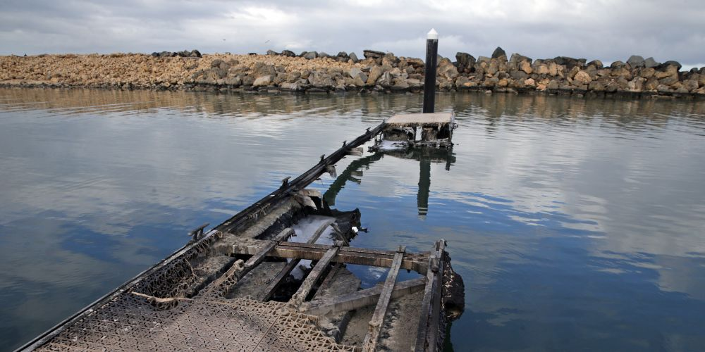 A jetty at Ocean Reef Marina was on fire last night. Pictures: Martin Kennealey