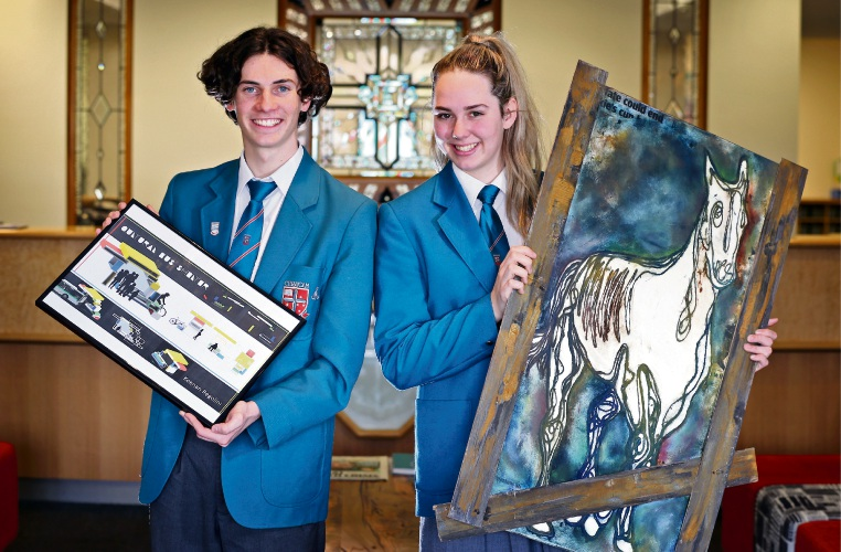 Keenan Regolini (17) of Inglewood with his work called Cultural Bus Shelter and Caitlin Wells (17) of Noranda with her artwork entitled Diago Lives.  Chisholm Catholic College''s Practical and Creative Arts exhibition is being held in the second week of term four. Picture: David Baylis