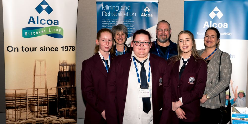 Pinjarra Senior High School teacher Julie Gray, Pinjarra Refinery central services manager Ray Smith and community relations officer Stephanie Gardner joined students Hayley Gough, Emly-Joy Dunster and Emily Heller at the mining summit.