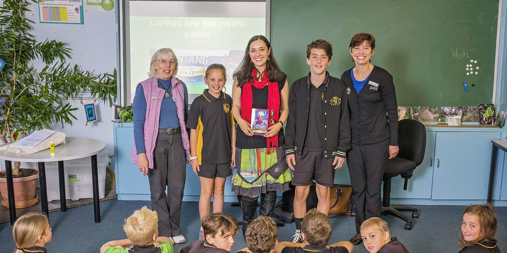 Cr Brenda Beacham, Tamara Moss, Murray library officer Anneke Scheepers and North Dandalup Primary School students celebrate Book Week.