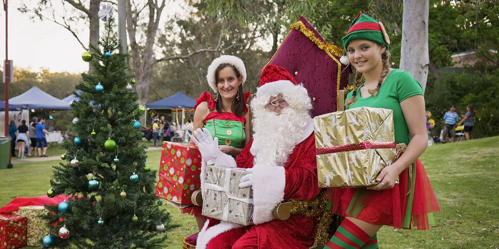 Santa and his helpers at last year's celebration.
