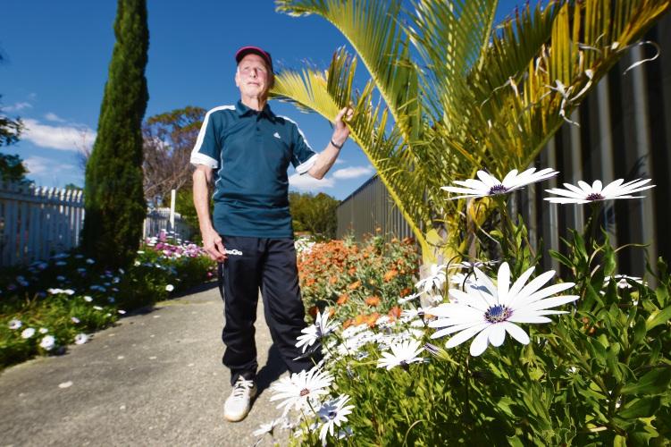 Booragoon resident Ian Backhouse maintains the walkway near his house. Picture: Jon Hewson