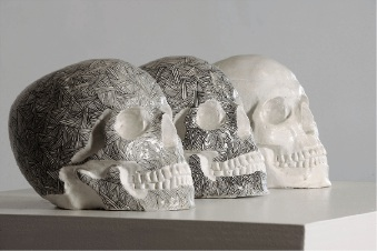 The sculpture. One of the lined skulls has been stolen.