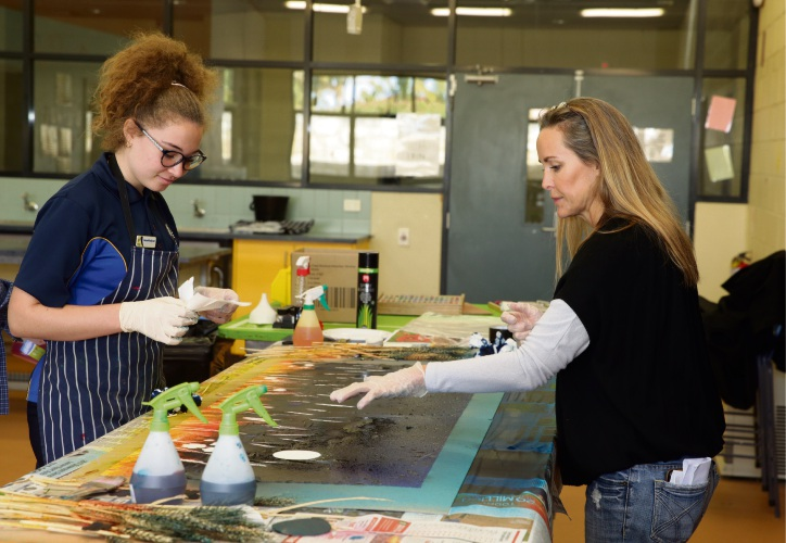 Artist Daniela Dlugocz with year 9 student Hannah Bodycoat at Kinross College. Picture: Martin Kennealey.