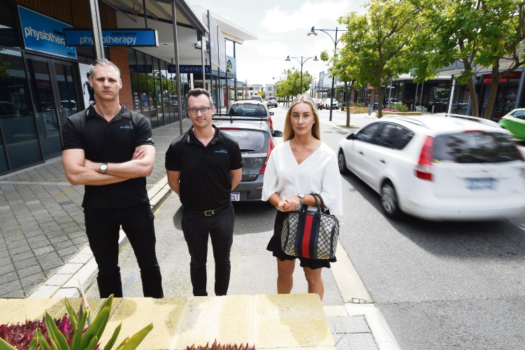 Michael Oostryck, John Klauz (both from Aubin Grove Physiotherapy) & Teresa McDonald (Centre Manager) are among those against the changes. Photo: Jon Hewson. d487225. communitypix.com.au