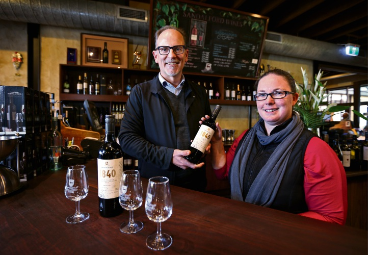 Sandalford chief executive Grant Brinklow with senior winemaker Hope Metcalf and the newly launched 1840 red wine range. Picture: David Baylis.