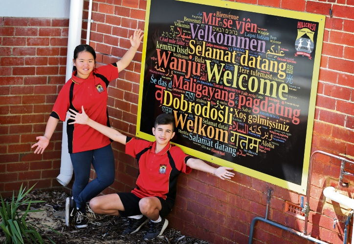 L-R: Year 6 Head Girl Denise Nguyen (12) and Year 6 Head Boy Byron Murphy (12) with the new welcome sign at Hillcrest Primary School. Picture: David Baylis