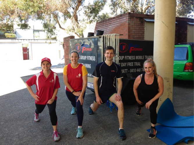 Heart Foundation staff limber up before a mobile gym session with Fuller Fitness.