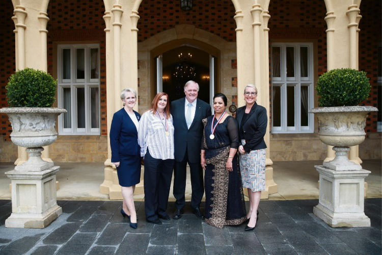 WA Governor Kim Beazley flanked by previous winners Lorraine Oldridge and Indrani Gunarathna, with Auspire representatives Anne Marie Farley (far left) and chief executive Morgan Lewis (far right). Picture: Andrew Ritchie