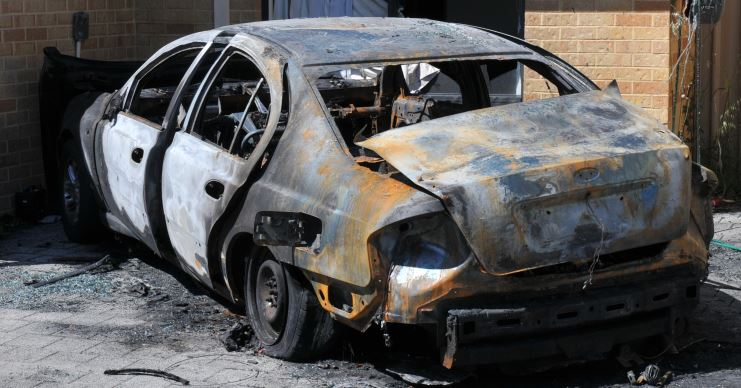 The silver Ford Falcon damaged by a car fire in Morley.