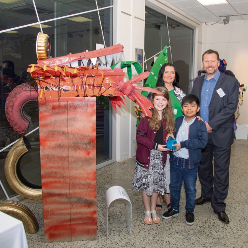 Hillman Primary School students Sean and Grace with teacher Suzie Robertson and Alcoa WA Refining Operations general manager Simon Pascoe, next to the winning sculpture.