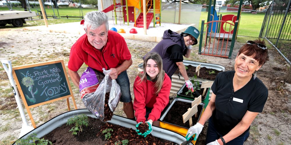 David Stevens and Bernadette Wheeler from Bunnings join Victoria Park Community Centre manager Nicky Macdougall and Eilyn Tee (behind) to establish the new garden. Picture: David Baylis