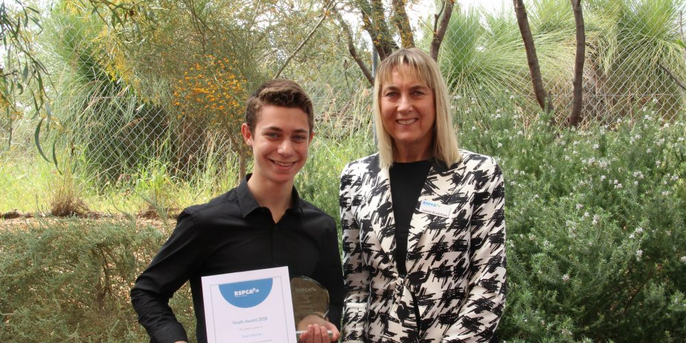 Dean Morris receives his award from RSPCA WA President Lynne Bradshaw.