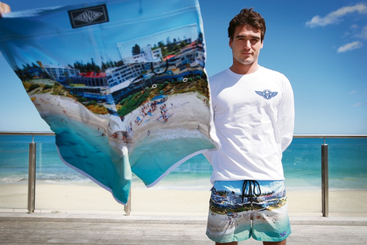 North Cottesloe SLSC member Reif Myers with the centenary boardies he designed. Picture: Andrew Ritchie