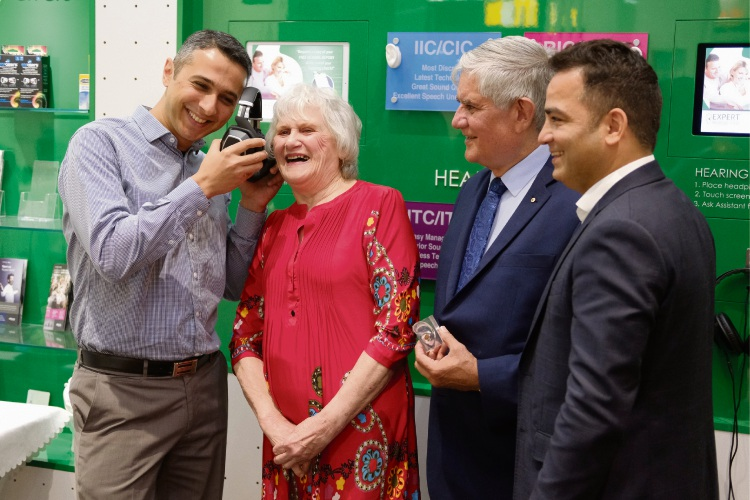 Local audiologist Eyad Alquoka with Swan View client Lucy Taylor, Hasluck MHR Ken Wyatt and Expert Hearing founder Amit Sahni.