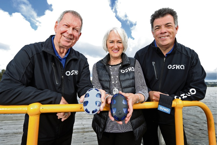 Oska Pulse co-founders and developers Michael and Shirley Hawker with Darren Wedge. Picture: David Baylis.