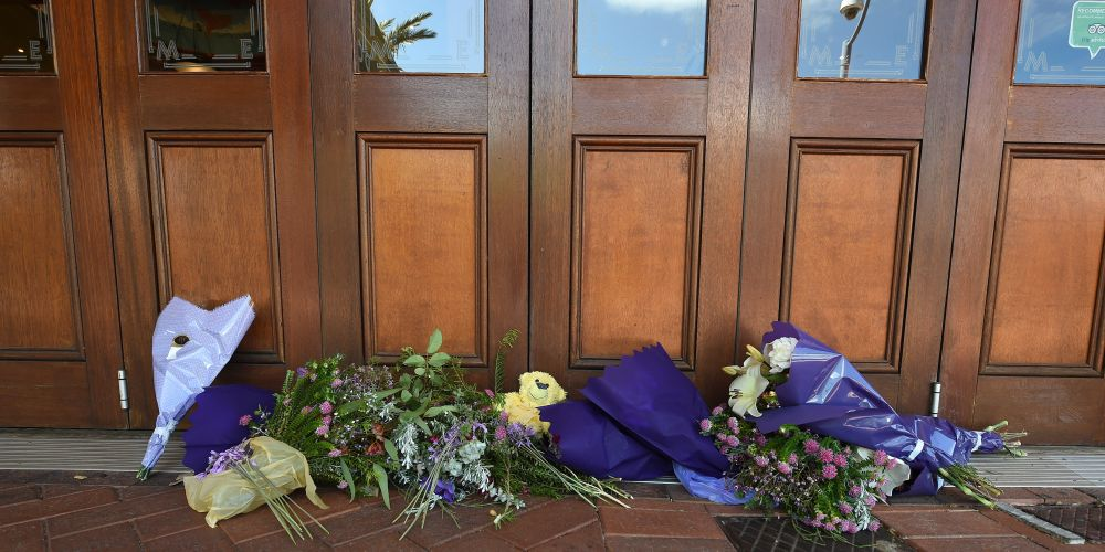 Flowers outside Dome Cafe in Rockingham, where a woman sought help before she died in hospital. Picture: Jon Hewson.