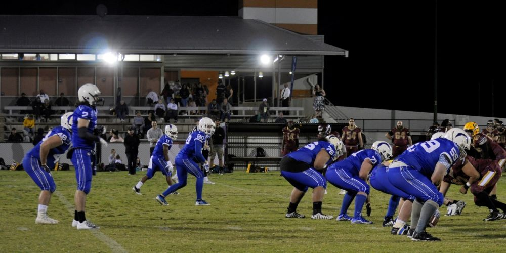 Perth Blitz' offence goes to work under lights at Lark Hill Sports Complex.