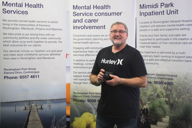 SRT staff member Philip Turner with the new Mental Health service banners which feature images taken by his photography group.