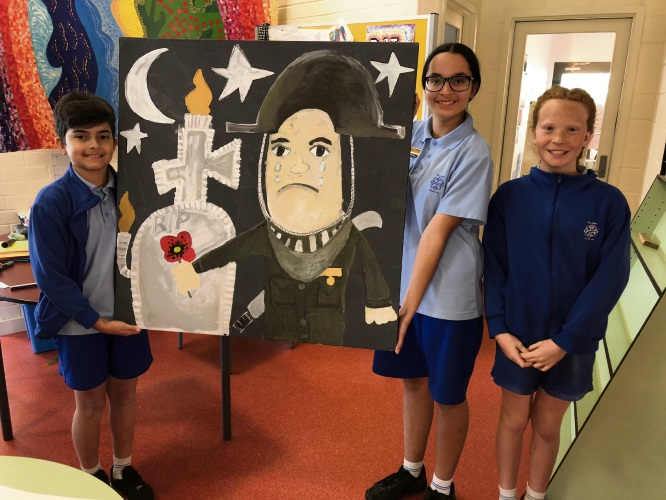 St Luke's Catholic Primary School students Jesse Butko, Olivia Anderson and Ella Simpson with their artwork.