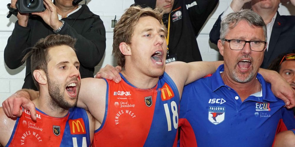 Bill Monaghan belts out the club song with his players.  Picture: Matt Beilken