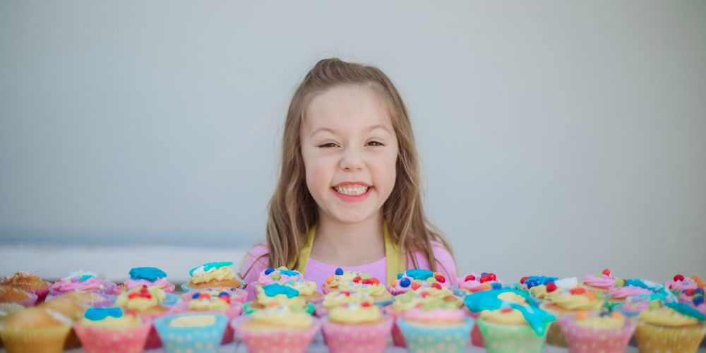 Evelyn Bicker at her cake stall. Picture: Tracy Joy Photography.
