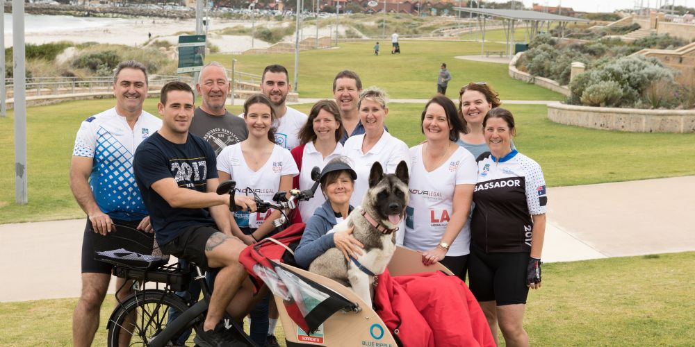 Friends and family of Carol Abramo (centre) who will pilot her trishaw for Ride to Conquer Cancer on October 13-14. Photo: Splash 22 Photography.